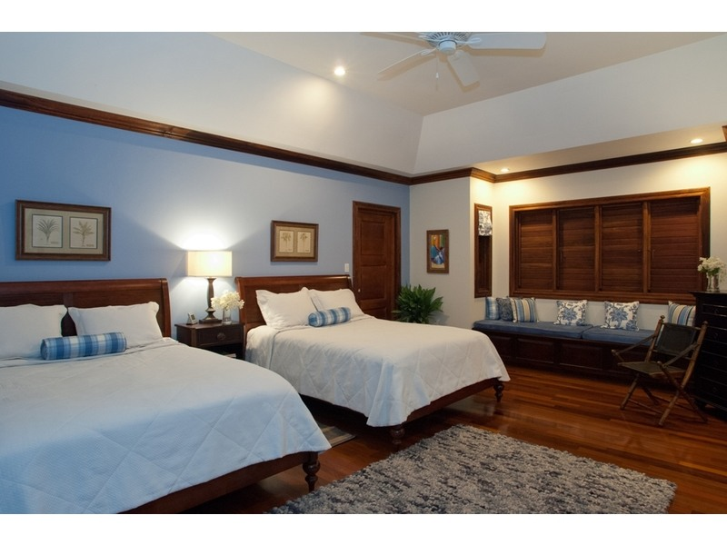The serene Blue Room with two queen beds / has private balcony