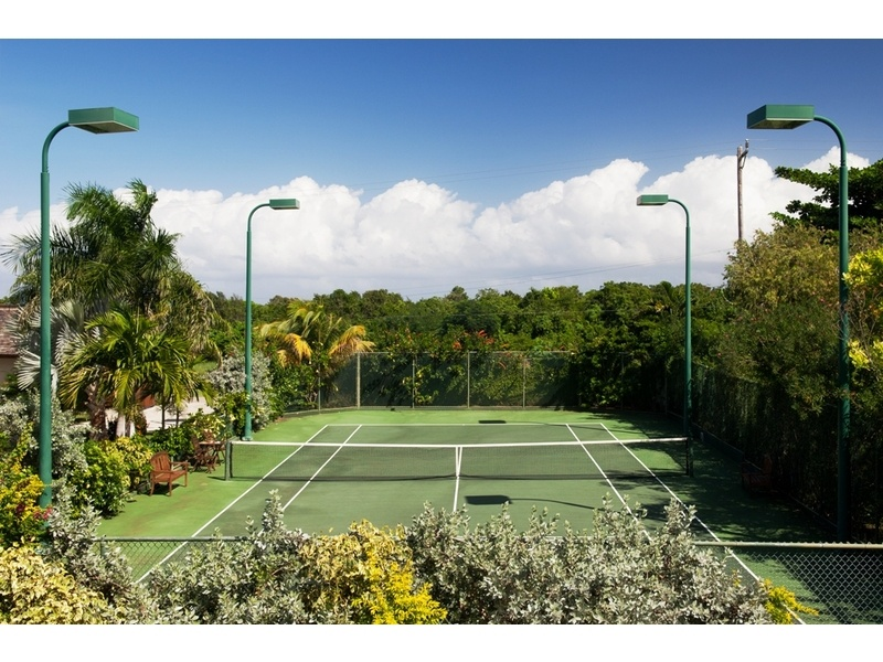 private tennis court - also has a basketball hoop on stand