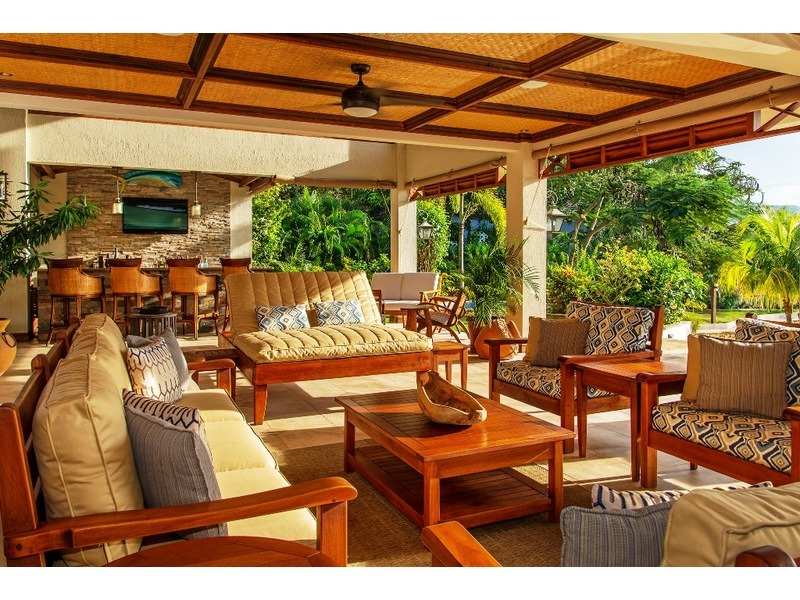 Spacious and beautifully appointed veranda and bar area with flat screen TV and wet bar