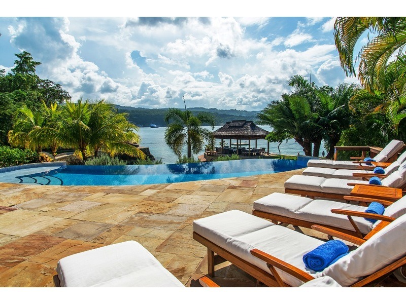 Spacious pool deck with lounge chairs - plus the lovely sea views!