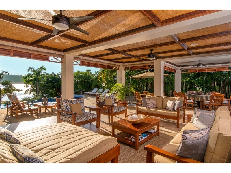Spacious covered patio area with wet bar - just steps to the pool ~