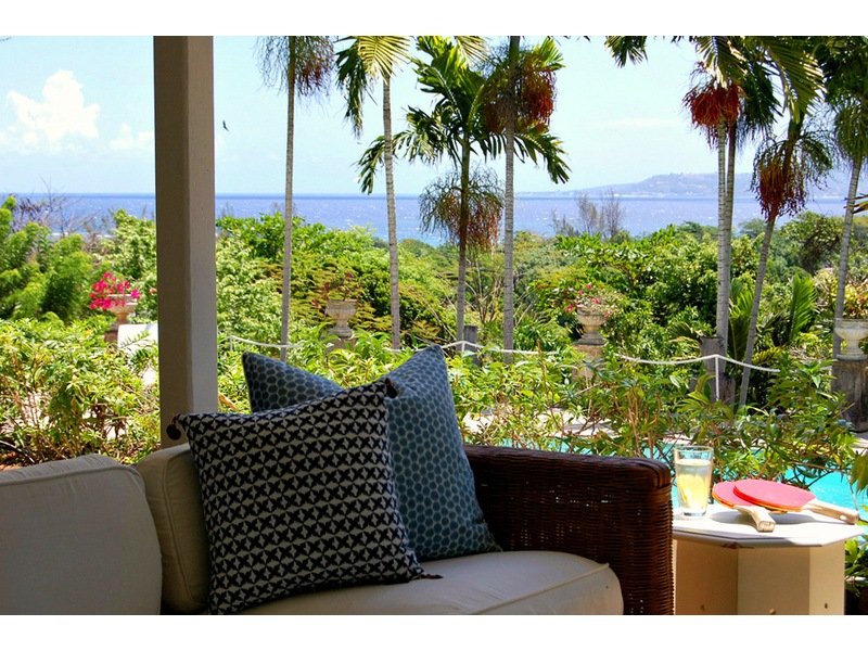 step outside your living room to the covered veranda - relax and enjoy the stunning  view!